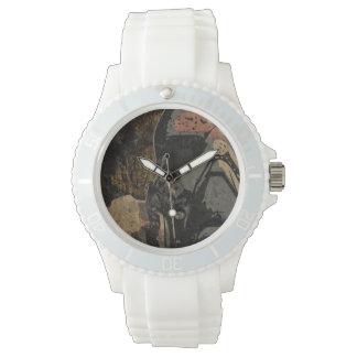 Man with protective mask on dark metal plate watches