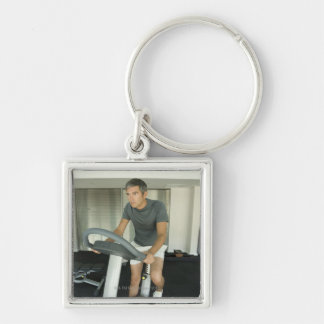 Man working out in a gym 2 key chain