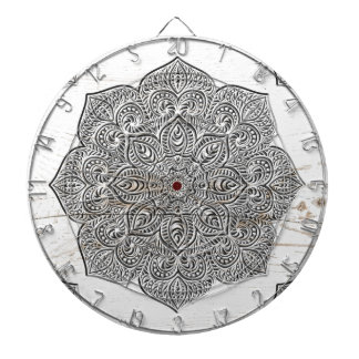 Mandala on white wood dartboard with darts