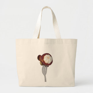 Mangosteen held by a fork bags