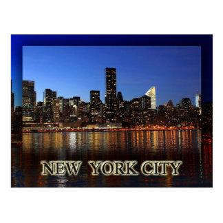 Manhattan skyline at night - New York City Postcard