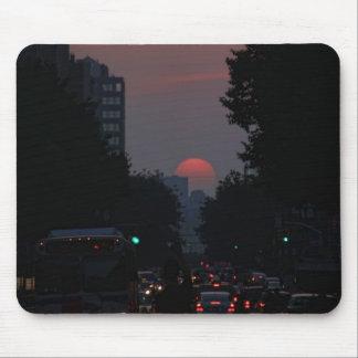 Manhattanhenge: setting pinkish orange sun 5/31/11 mouse pads