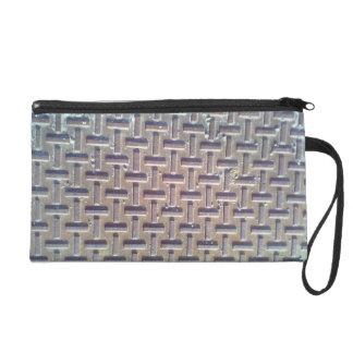 Manhole cover wristlet purses