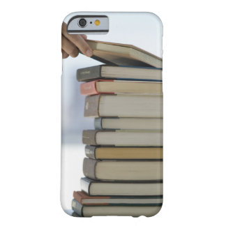 Man's hand taking a book from a stack of books barely there iPhone 6 case