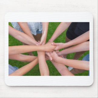 Many arms of children holding hands together mouse pad