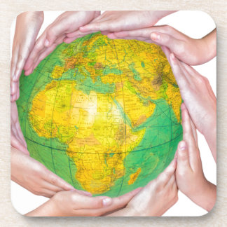 Many arms of children with hands holding globe drink coasters