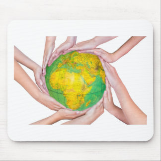 Many arms of children with hands holding globe mouse pad