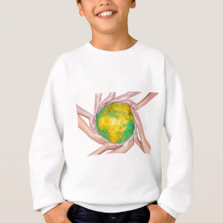 Many arms of children with hands holding globe sweatshirt