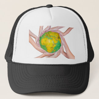Many arms of children with hands holding globe trucker hat