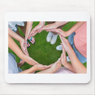 Many arms of children with hands making circle mouse pad