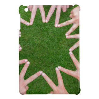Many arms of children with hands making star iPad mini covers