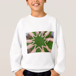 Many arms of children with hands making star sweatshirt