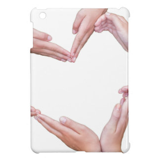 Many arms of girls construct heart on white case for the iPad mini