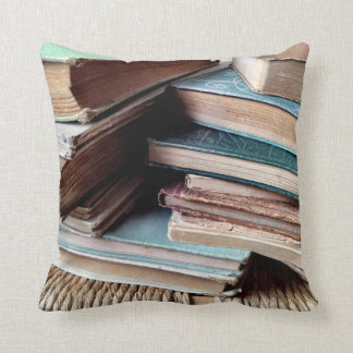 Many books on an old chair throw pillow