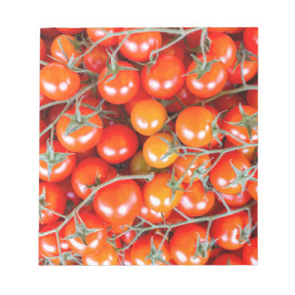 Many bunches of red vine tomatoes notepad