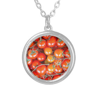 Many bunches of red vine tomatoes silver plated necklace