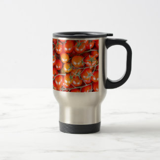 Many bunches of red vine tomatoes travel mug