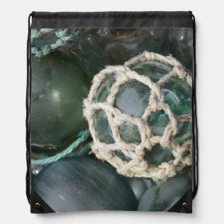 Many glass fishing floats, Alaska Drawstring Bag