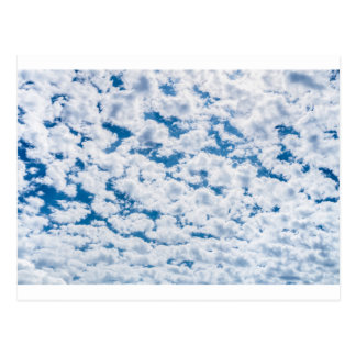 Many little white clouds and blue sky postcard
