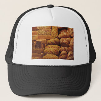 Many mixed breads and rolls background trucker hat