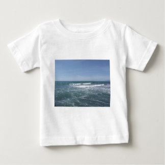 Many people surfing on surfboards in the sea baby T-Shirt