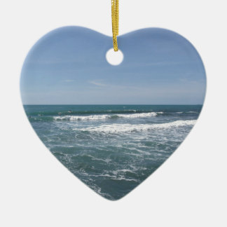 Many people surfing on surfboards in the sea ceramic heart decoration