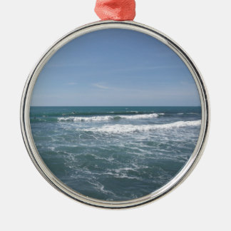 Many people surfing on surfboards in the sea metal ornament