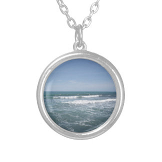 Many people surfing on surfboards in the sea silver plated necklace