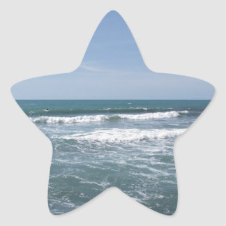 Many people surfing on surfboards in the sea star sticker