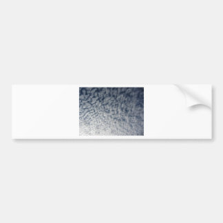Many soft clouds against blue sky background bumper sticker