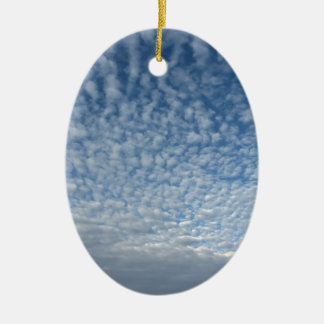 Many soft clouds against blue sky background ceramic ornament