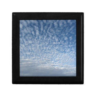 Many soft clouds against blue sky background gift box
