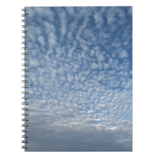 Many soft clouds against blue sky background notebook