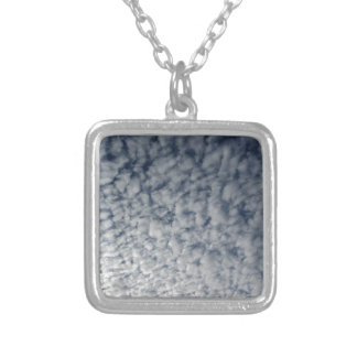 Many soft clouds against blue sky background silver plated necklace