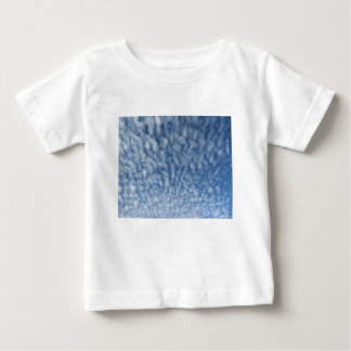 Many soft little clouds against sky background baby T-Shirt