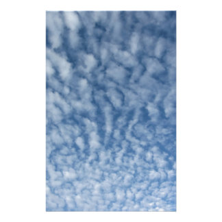 Many soft little clouds against sky background stationery