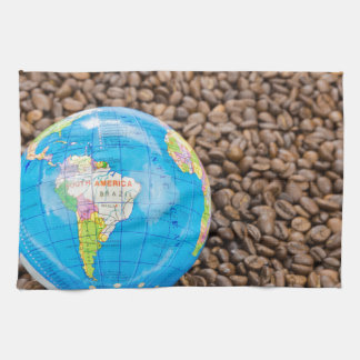 Many whole coffee beans with South America globe Towels