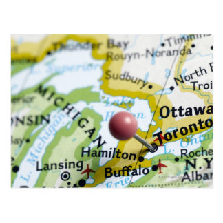 Map pin placed on Toronto Canada on map Postcards