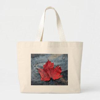 Maple leaf on ice large tote bag