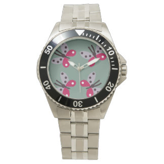 maroon butterfly design on the watch. watch