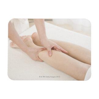 Massage therapist applying foot massage rectangular photo magnet
