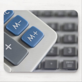 Mathematical symbols on a calculator and a mouse pad