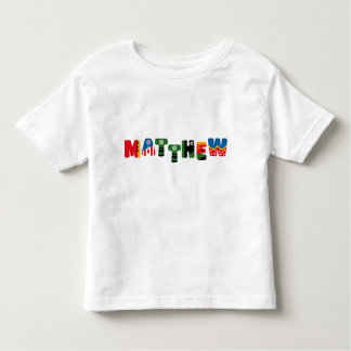 Matthew T Shirt in superhero letters