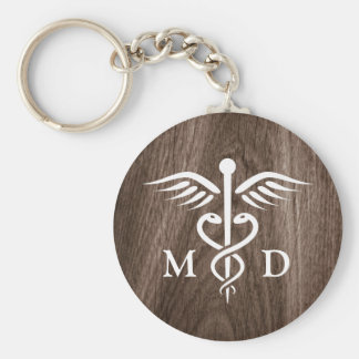 MD medical doctor with caduceus on wood background Key Ring