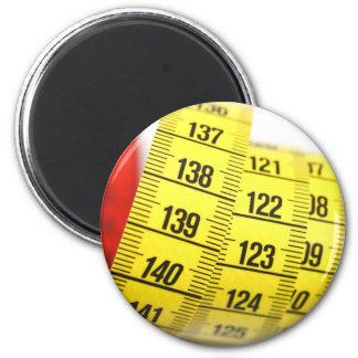 Measuring tape fridge magnet
