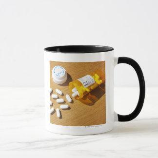 Medication spilled on table mug