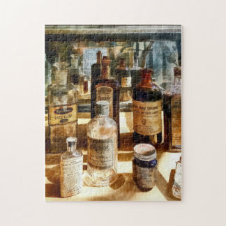 Medicine Bottles in Glass Case Jigsaw Puzzle