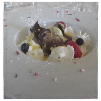 Melted chocolate ball with zabaglione cream napkin