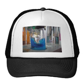 Melted glass vessel with solution mesh hat