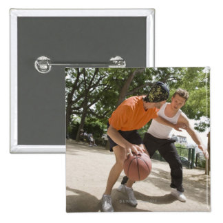 Men playing basketball outdoors 15 cm square badge